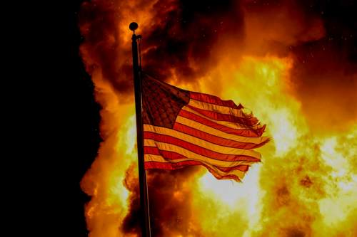 US flag in flames